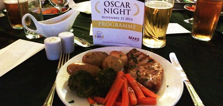 Dinner's served! The pork steak main course with the evening's programme
